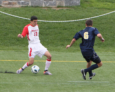 POUGHKEEPSIE, NY - SEPTEMBER 26: Marist Mens Soccer verses La Salle at Marist College on September 26, 2010 in Poughkeepsie New York.  Marist's #12 Anthony Rozmus moves ball past La Salle defender.   Photo by Sandy Tambone