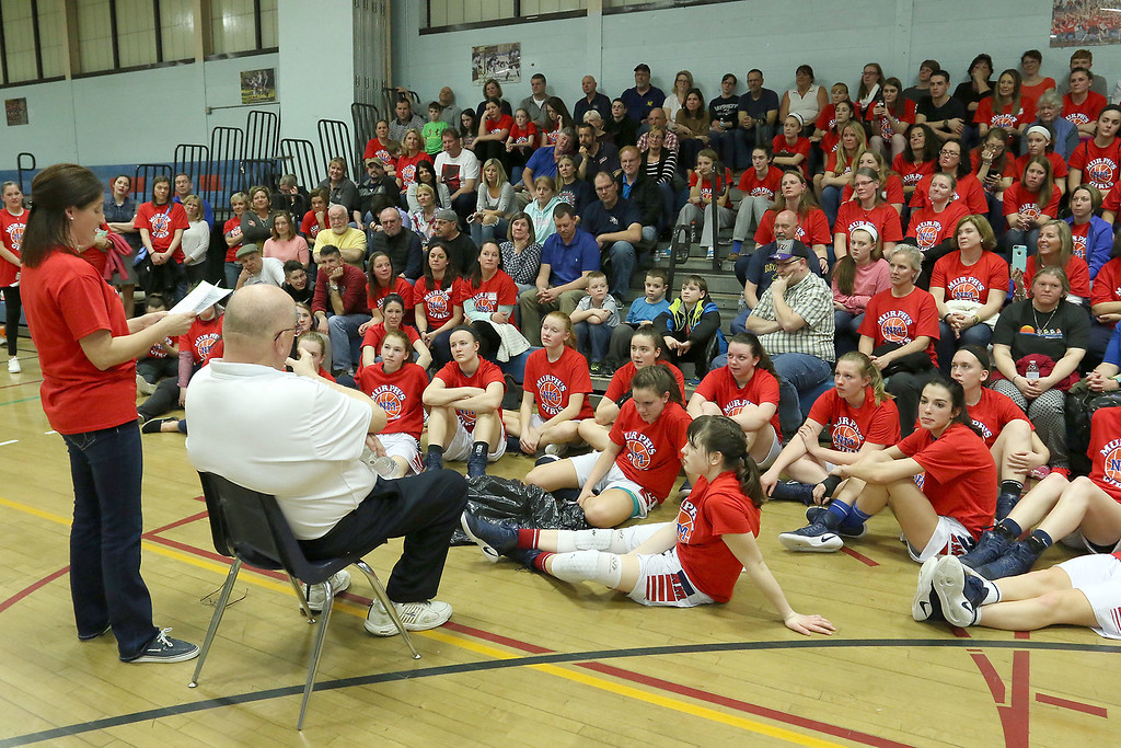 . North Middlesex Regional High School girls basketball coach Pat Murphy, siting in front, listens to his daughter Kerry (Murphy) McCarthy as she talks about him after their game against Notre Dame Academy on Thursday night February 23, 2017. SENTINEL & ENTERPRISE/JOHN LOVE