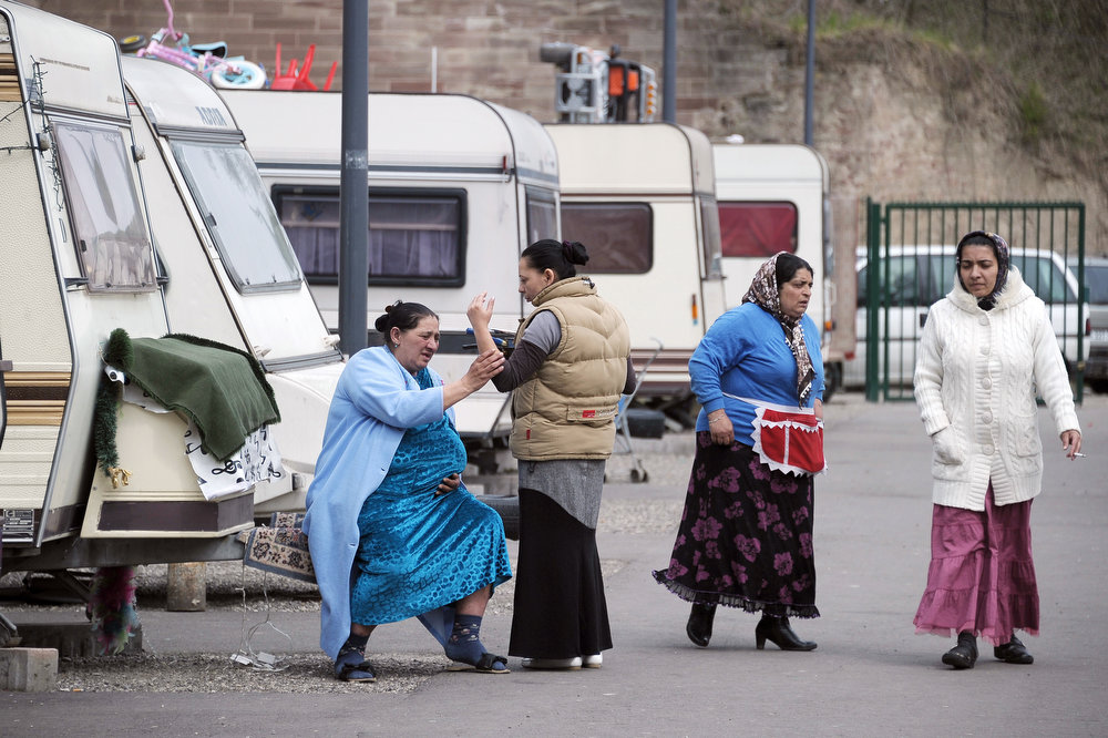 . Women  of the Roma community chat together in a camp on April 8, 2013 in Strasbourg, eastern France, on International Roma Day.   FREDERICK FLORIN/AFP/Getty Images