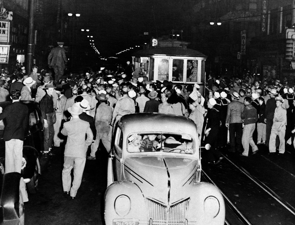 . Soldier, sailors and marines who roamed the street of Los Angeles, June 7, 1943, looking for hoodlums in zoot suits, stopped this streetcar during their search. Crowds jammed downtown streets to watch the service men tear clothing off the zoot suiters they caught. (AP Photo)