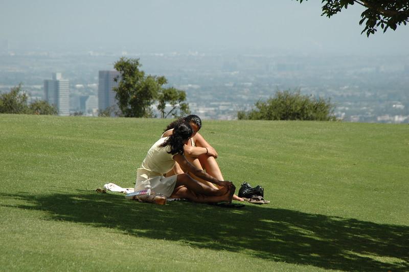 Kissing girls in Getty Center park