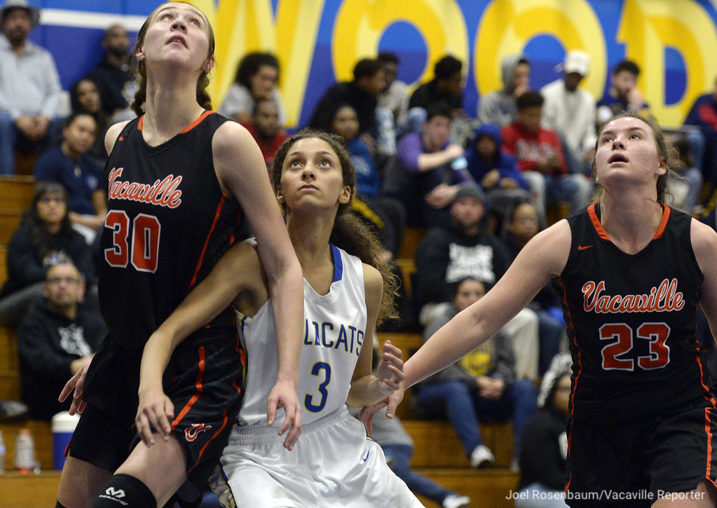 . Wood\'s Sophia Adams battles for position underneath the boards for a rebound during a free-throw attempt with Emily Silva (left) and Brook Mitchell during the second quarter.