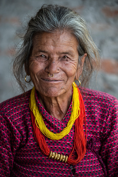 Little is known of Tamang history but it is believed that the Tamangs have been in the Himalayan zone of Nepal longer than any other group. Currently they inhabit approximately half of this zone.  The Tamang people are believed to have come from Tibet, possibly around 3000 years ago, and are Nepals largest ethnic group. The Tamangs are distributed densely within central Nepal but are also present throughout the country and in Darjeeling, India. They have their own distinct culture, tradition, language, religion and social system. It is believed that the Tamangs were self-ruled and autonomous until 232 years ago. During the last two centuries, Tamangs have been most discriminated and exploited community of Nepal.  Because of their proximity to the capital city, governments have considered that an empowered Tamang community could pose a possible risk to their regimes and consequently have striven to ensure that the Tamang people have remained disenfranchised, exploited and dominated. They were neither accepted into government posts, whether administrative, judicial or political, nor allowed to accept foreign employment till 1950. They were forced to serve as a reserve labour pool for the services of the ruling group.  The Tamangs have been terribly exploited even amongst Nepalis. According to the Nepali civil code of 1856, their status was Shudra (The second lowest rank in the Hindu hierarchical system), which meant that they could be killed and enslaved by those of a higher caste. This situation prevailed until the new civil code was formulated in 1962.Much of their land was redistributed and this poverty and lack of a voice within Nepal remains a serious issue in modern Nepal.  Low Hills, Nepal, 2019.