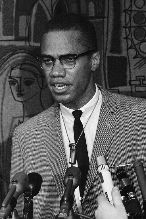. Black Muslim leader Malcolm X, seen in Chicago preparing for a speaking engagement May 25, 1964.  (AP Photo/Edward Kitch)