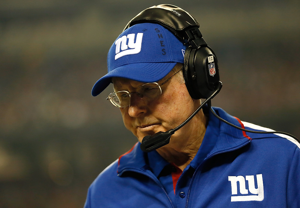 Description of . Head coach Tom Coughlin of the New York Giants reacts after an injury to Chris Snee #76 against the Atlanta Falcons at Georgia Dome on December 16, 2012 in Atlanta, Georgia.  (Photo by Kevin C. Cox/Getty Images)