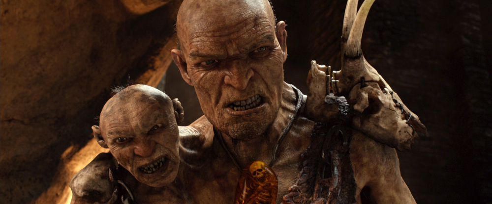 Description of . This film image released by Warner Bros. Pictures shows This film image released by Warner Bros. Pictures shows Gen. Fallon, voiced by Bill Nighy, right, and Fallonís Small Head, voiced by John Kassir, in a scene from
