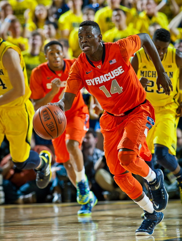 . Syracuse guard Kaleb Joseph (14) dribbles on a fast break in the first half of an NCAA college basketball game against Michigan at Crisler Center in Ann Arbor, Mich., Tuesday, Dec. 2, 2014. (AP Photo/Tony Ding)