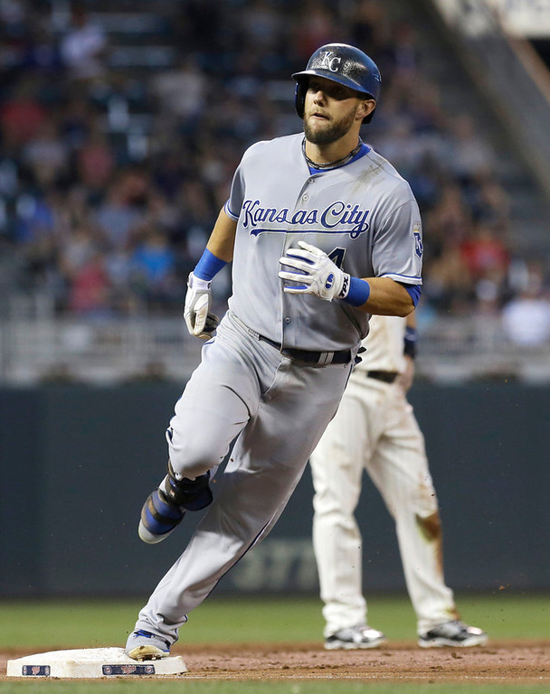. Kansas City Royals\' Alex Gordon rounds third base after hitting a solo home run off Minnesota Twins pitcher Andrew Albers in the third inning. (AP Photo/Jim Mone)