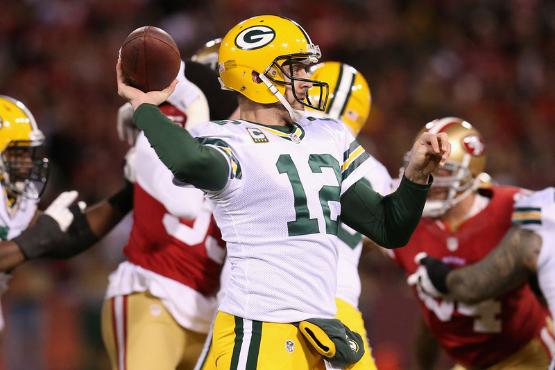 . Quarterback Aaron Rodgers #12 of the Green Bay Packers throws the ball against the San Francisco 49ers in the first quarter during the NFC Divisional Playoff Game at Candlestick Park on January 12, 2013 in San Francisco, California.  (Photo by Stephen Dunn/Getty Images)