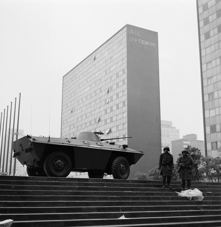 . Mexican troops stands by their machine guns in front of the Chihuahua building on the Plaza of the Three Cultures in Mexico City, Oct. 3, 1968. This was the scene of last night\'s bloody battle between soldiers, police and students. (AP Photo)