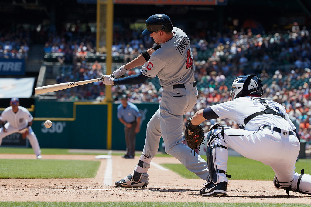 . Cleveland Indians center fielder Bradley Zimmer (4) hits a single against the Detroit Tigers during the second inning of a baseball game in Detroit, Sunday, July 2, 2017. (AP Photo/Rick Osentoski)