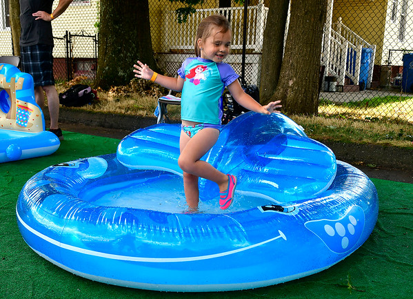 7/12/2019 Mike Orazzi | Staff Autumn Larsen,3, while at the Imagine Nation's Water Carnival on Friday morning.