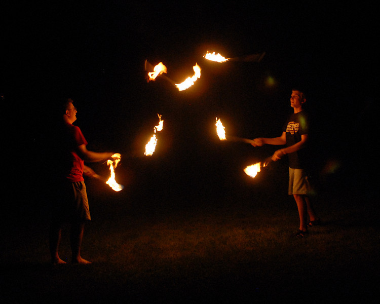 Ed and Ben juggling fire passing pins.jpg
