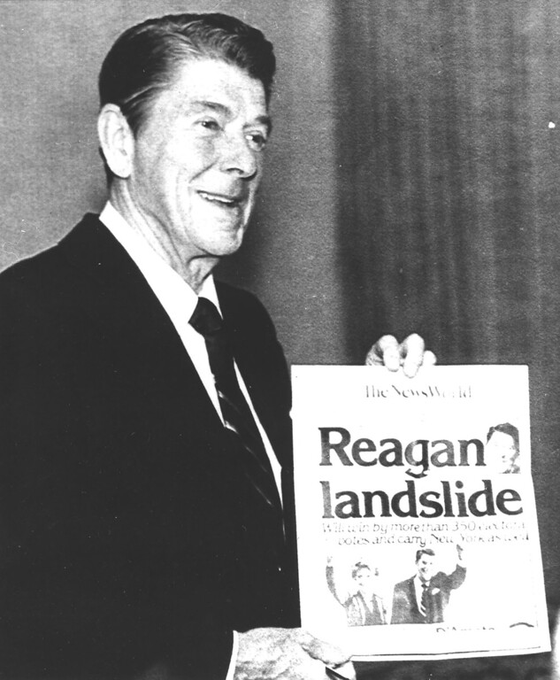. 1980: Ronald Reagan. President-electet Ronald Reagan, the movie actor turned politican, displays clipping showing victory Tuesday night November 4, 1980, over President Jimmy Carter in his Los Angeles hotel suite. Reagan won election by landslide. (AP-Photo/j/stf)