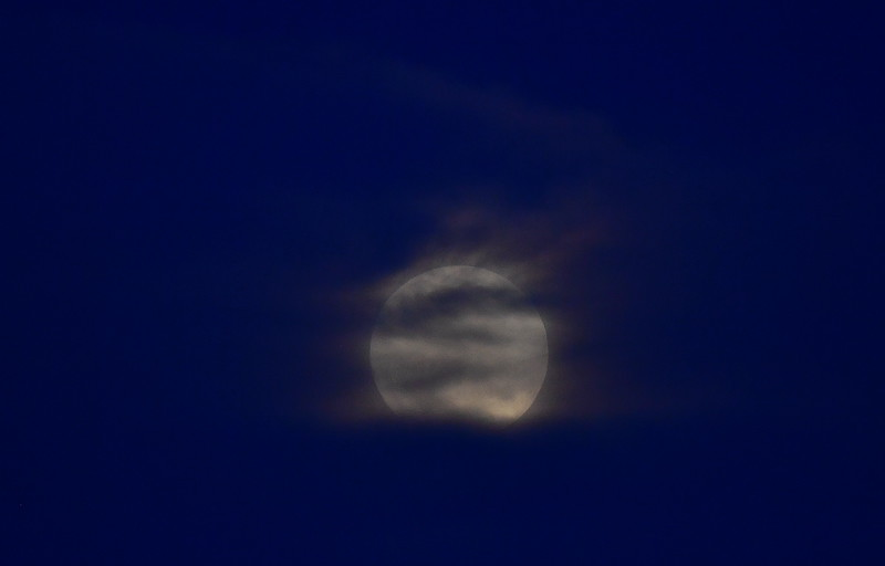 Full moon through the clouds