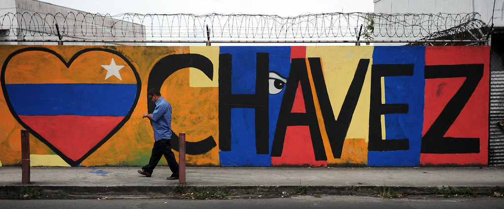 . A man passes by in front of a graffitti dedicated to Venezuelan President Hugo Chavez in Panama City, on March 6, 2013. Venezuelans began Wednesday to bid farewell to late President Hugo Chavez, whose body was to lie in state for three days to honor the firebrand leftist who ruled the oil-rich nation for 14 years. AFP PHOTO/ Rodrigo  ARANGUA/AFP/Getty Images