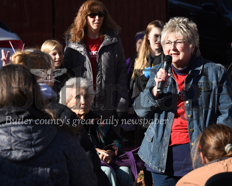 Harold Aughton/Butler Eagle: Karen Gianechini of Callery sung a chorus of Jesus Loves Me to those gathered Sunday afternoon in Rotary Park. Members of the Victory Church served hot meals and handed out turkeys to those in attendance.
