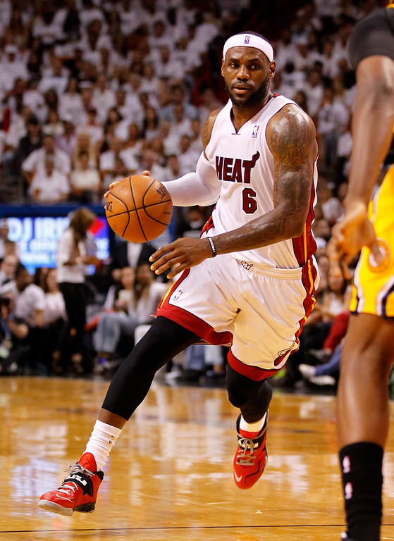 . MIAMI, FL - MAY 30: LeBron James #6 of the Miami Heat drives to the basket against the Indiana Pacers during Game Six of the Eastern Conference Finals of the 2014 NBA Playoffs at American Airlines Arena on May 30, 2014 in Miami, Florida.  (Photo by Mike Ehrmann/Getty Images)