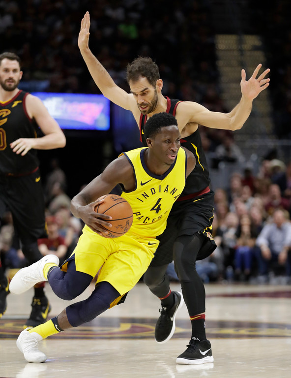 . Indiana Pacers\' Victor Oladipo (4) drive past Cleveland Cavaliers\' Jose Calderon (81), from Spain, in the second half of Game 5 of an NBA basketball first-round playoff series, Wednesday, April 25, 2018, in Cleveland. The Cavaliers won 98-95. (AP Photo/Tony Dejak)