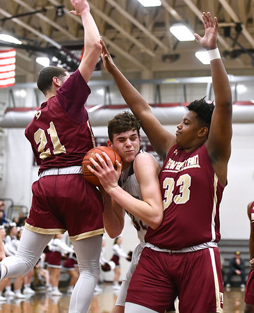 1/3/2020 Mike Orazzi | StaffrBristol Central High School's Donovan Clingan (32) and New Britain's Nyzaiah Diaz (21) and Dontay Bishop (33) during Friday night's boys basketball game in Bristol.