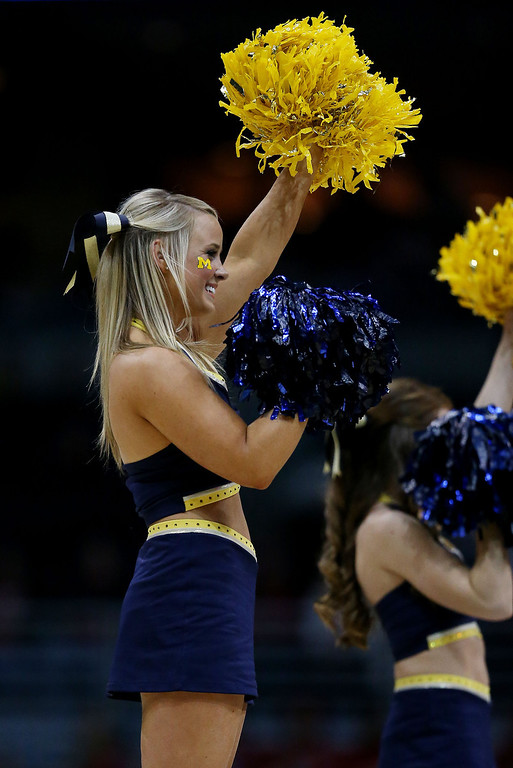 . Michigan Wolverines cheerleaders perform against the Wofford Terriers during the second round of the 2014 NCAA Men\'s Basketball Tournament at BMO Harris Bradley Center on March 20, 2014 in Milwaukee, Wisconsin.  (Photo by Jonathan Daniel/Getty Images)