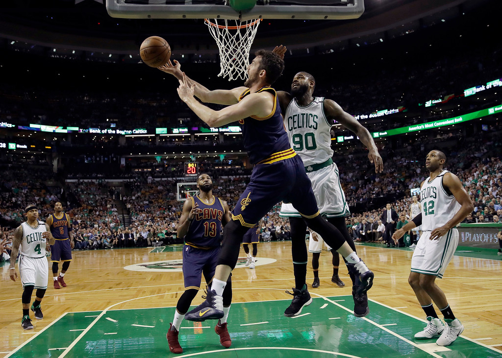 . Cleveland Cavaliers forward Kevin Love shoots from under the basket as Boston Celtics forward Amir Johnson (90) defends during the first quarter of Game 1 of the NBA basketball Eastern Conference finals, Wednesday, May 17, 2017, in Boston. (AP Photo/Charles Krupa)