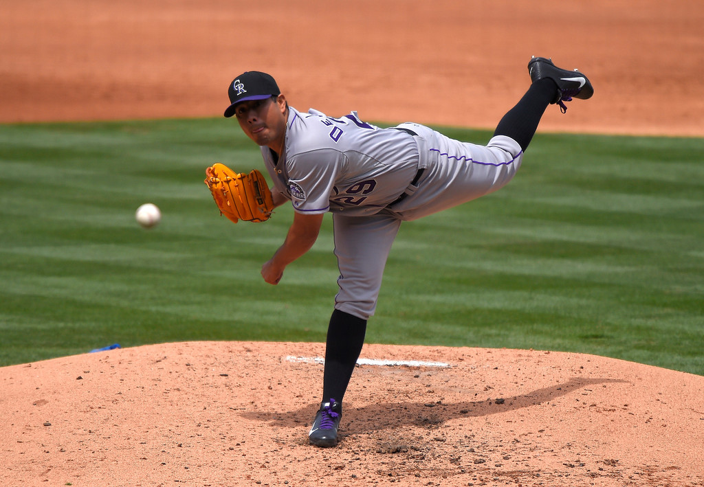 . Colorado Rockies starting pitcher Jorge De La Rosa throws to the plate during the second inning of a baseball game against the Los Angeles Dodgers, Sunday, April 27, 2014, in Los Angeles. (AP Photo/Mark J. Terrill)