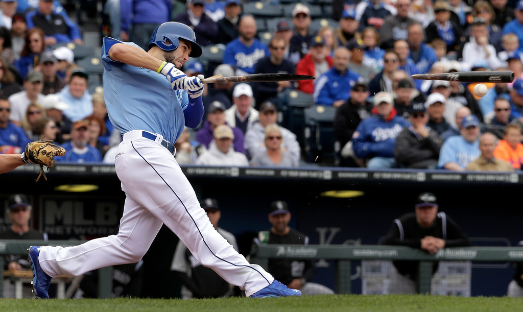 . Kansas City Royals\' Eric Hosmer breaks his bat as he grounds out during the second inning of a baseball game against the Colorado Rockies Wednesday, May 14, 2014 in Kansas City, Mo. (AP Photo/Charlie Riedel)