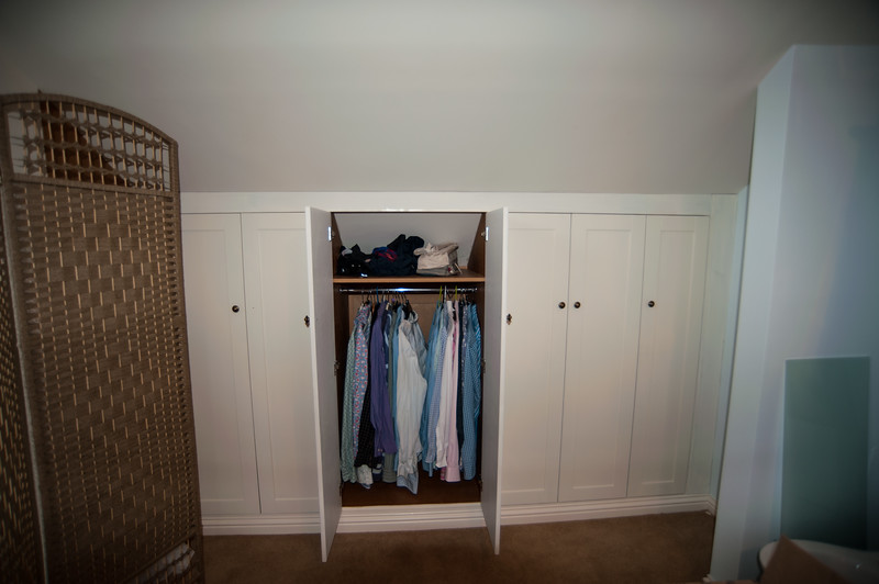 Wardrobs following the shape of attic room shaker style doors