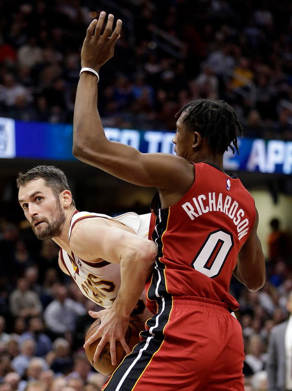 . Cleveland Cavaliers\' Kevin Love, left, drives against Miami Heat\'s Josh Richardson in the first half of an NBA basketball game, Tuesday, Nov. 28, 2017, in Cleveland. (AP Photo/Tony Dejak)