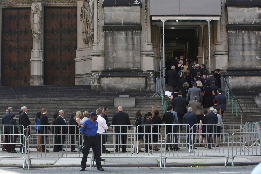 . People arrive at the the Cathedral Church of Saint John the Divine for the funeral service for James Gandolfini, Thursday, June 27, 2013 in New York.   (AP Photo/Mary Altaffer)