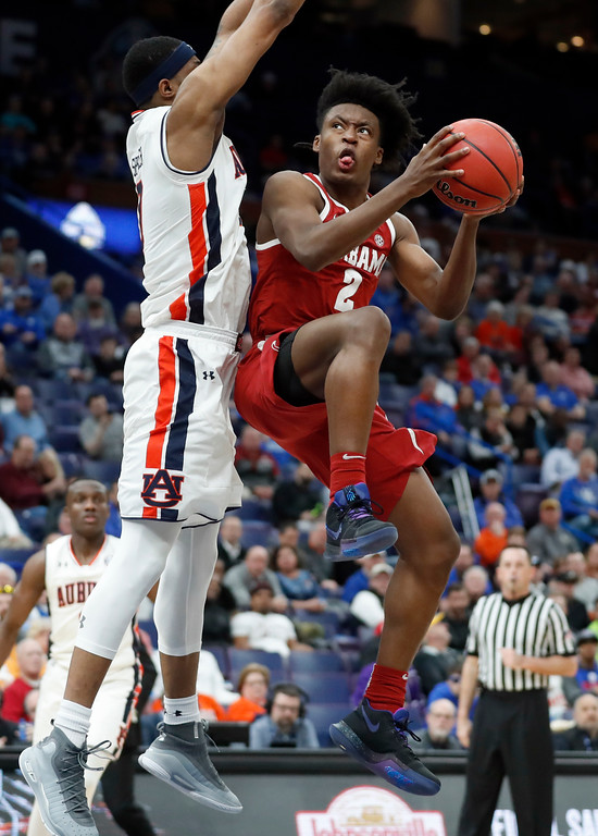 . Alabama\'s Collin Sexton, right, heads to the basket as Auburn\'s Horace Spencer defends during the second half in an NCAA college basketball quarterfinal game at the Southeastern Conference tournament Friday, March 9, 2018, in St. Louis. Alabama won 81-63. (AP Photo/Jeff Roberson)