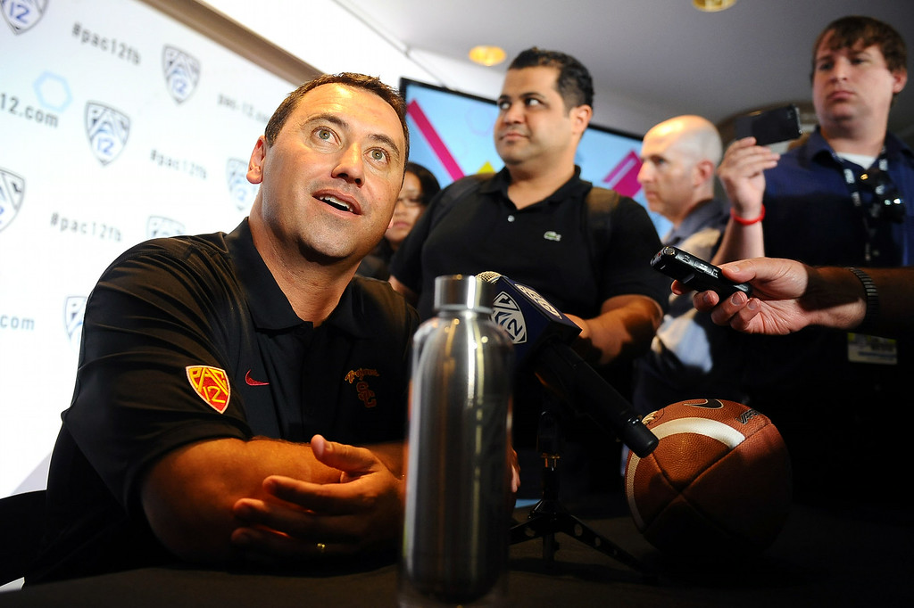 . USC Head Coach Steve Sarkisian answers questions during PAC-12 Football Media Day at the Paramount Theater in Los Angeles, Ca July 23, 2014.(Andy Holzman/Los Angeles Daily News)