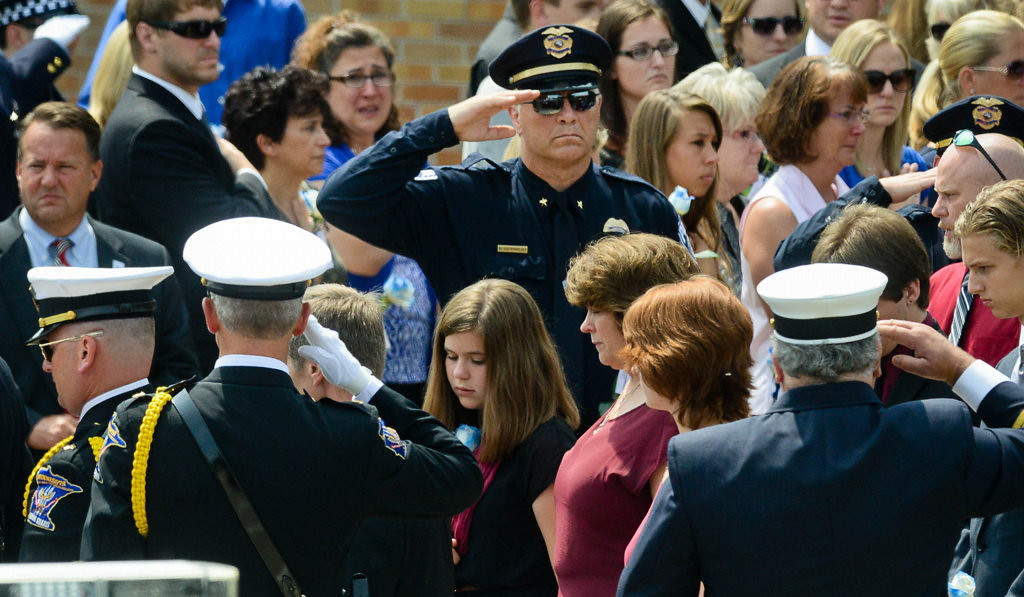 . The family of officer Patrick, including his wife of 26 years, Michelle, and daughters Erin, 17, and Amy, 13, follow as the casket is carried out of St. Stephen�s after the funeral service Wednesday. (Pioneer Press: Ben Garvin)
