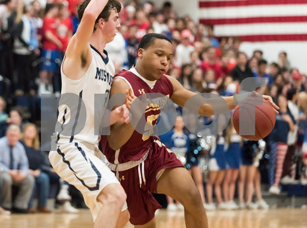 03/12/18 Wesley Bunnell | Staff New Britain basketball was eliminated from the Division II state tournament with a 56-41 loss to Immaculate in a game played at Immaculate on Monday night. Kaiyon Gunn (55).