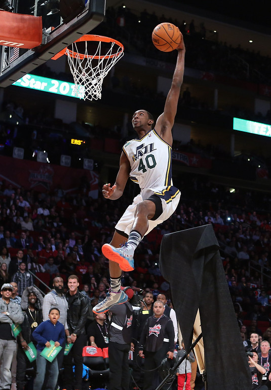 . HOUSTON, TX - FEBRUARY 16:  Jeremy Evans of the Utah Jazz jumps over a painting of himself in the final round during the Sprite Slam Dunk Contest part of 2013 NBA All-Star Weekend at the Toyota Center on February 16, 2013 in Houston, Texas. (Photo by Ronald Martinez/Getty Images)