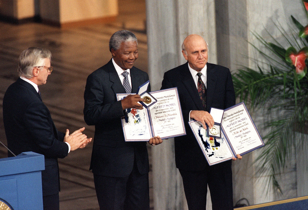 . Nelson Mandela, President of South African African National Congress (C) and South African President Frederik de Klerk (R) display 09 December 1993 in Oslo their Nobel Prizes after being awarded jointly for their work to end apartheid peacefully.. De Klerk shared a Nobel Peace Prize with Mandela for their efforts in securing a peaceful transition from apartheid rule. De Klerk resigned as leader of South African National Party in 1997, having served as Mandela\'s second deputy President until 1996.  AFP PHOTO GERARD JULIEN (Photo credit should read GERARD JULIEN/AFP/Getty Images)