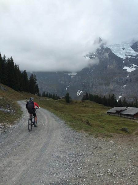 Jackie biking uphill toward Kleine Scheidegg