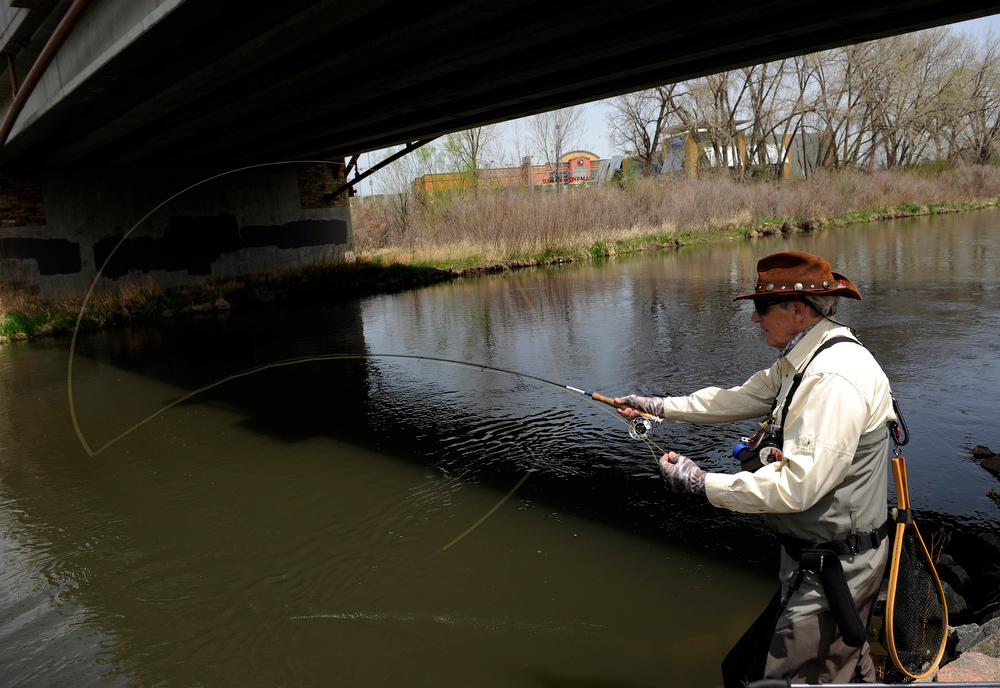 . Urban fishing on Monday, May 13, 2013 along the South Platte River in Englewood as  John Davenport casts from under the River Point Parkway bridge.   (Photo By Cyrus McCrimmon/The Denver Post)
