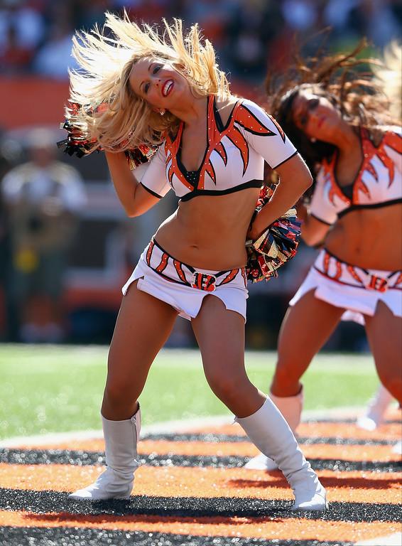 . Cincinnati Bengals cheerleaders perform during the NFL game against the Green Bay Packers at Paul Brown Stadium on September 22, 2013 in Cincinnati, Ohio.  (Photo by Andy Lyons/Getty Images)