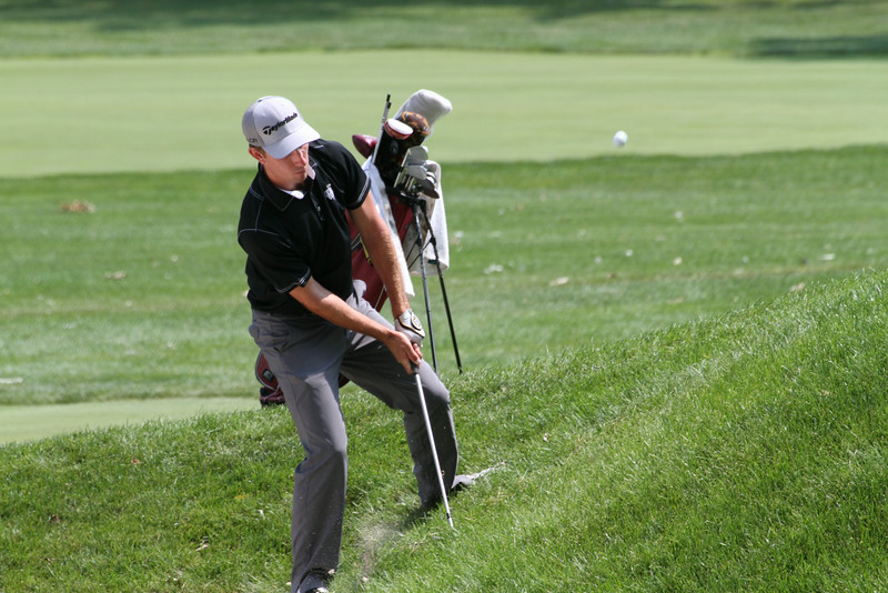 A player attempts to chip onto the green during the first round of the 2014 Western Amateur.