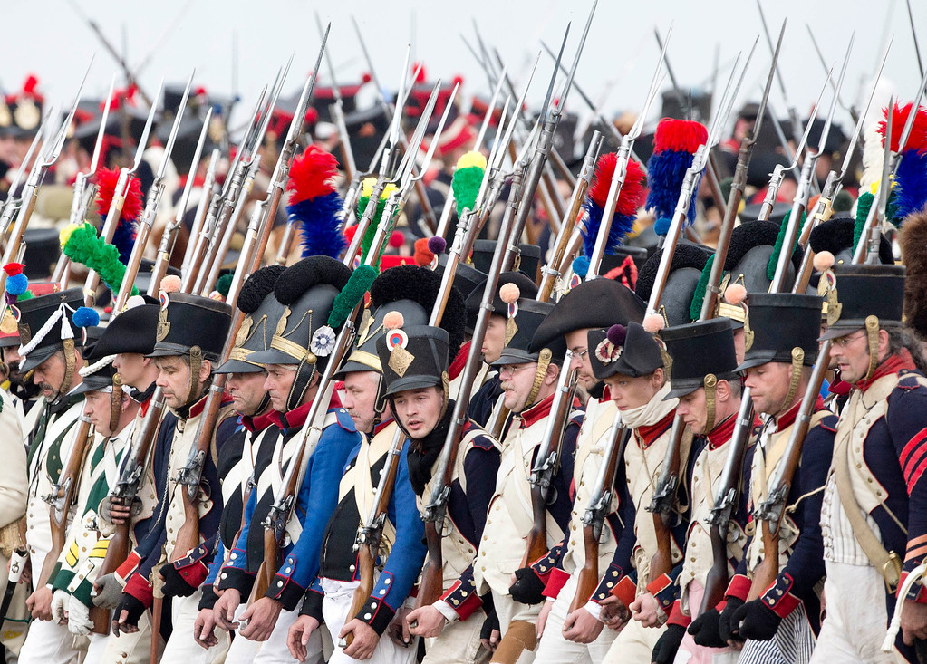 . Troops march during the reconstruction of the Battle of the Nations at the 200th anniversary near Leipzig, central Germany, Sunday, Oct. 20, 2013. Some 6,000 members of military-historic associations from 24 countries took part in this performance.  (AP Photo/Jens Meyer)