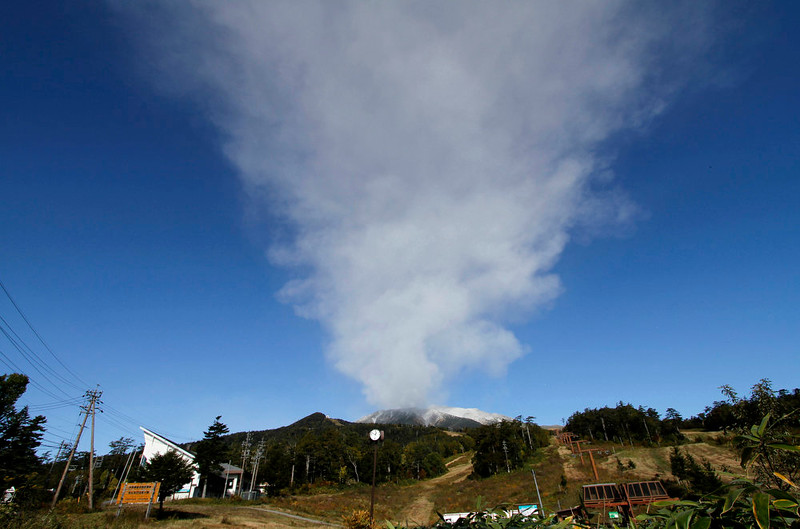 . Plumes of smoke and ash billow from Mount Ontake as it continues to erupt for the third day in Otaki village, in Nagano prefecture, Japan, Monday, Sept. 29, 2014. Mount Ontake erupted shortly before noon at perhaps the worst possible time, with at least 250 people taking advantage of a beautiful fall Saturday to go for a hike. The blast spewed large white plumes of gas and ash high into the sky, blotted out the midday sun and blanketed the surrounding area in ash. Rescue workers have found 30 or more people unconscious and believed to be dead near the peak of the erupting volcano in central Japan, local government and police said Sunday.  (AP Photo/Koji Ueda)