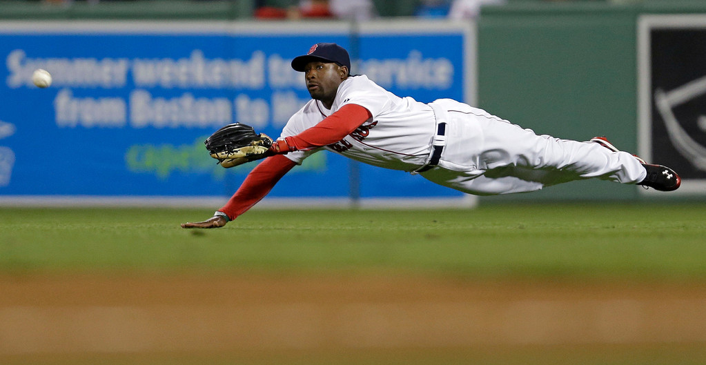 . Boston Red Sox center fielder Jackie Bradley Jr. dives for a blooper single by Minnesota Twins Aaron Hicks in the fifth inning. (AP Photo/Gerald Herbert)