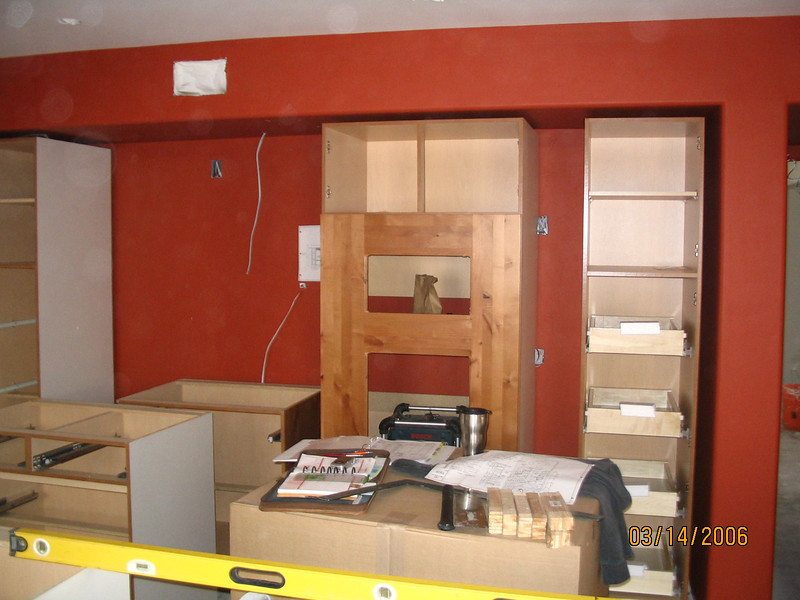 Kitchen cabinets have been delivered and are being set.