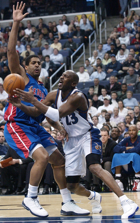 . Washington Wizards\' Michael Jordan (23) tries to get past Detroit Pistons\' Corliss Williamson, left, during second-half action of the Pistons\' 94-90 overtime win Tuesday, March 18, 2003, in Washington. (AP Photo/Nick Wass)