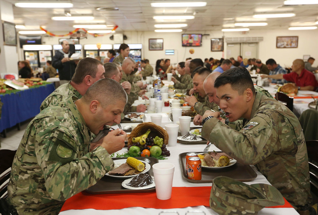 . NATO soldiers have their Thanksgiving meal at Resolute Support headquarters, in Kabul, Afghanistan, Thursday, Nov. 24, 2016. (AP Photo/Rahmat Gul)
