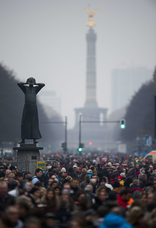 . People crowd the17th June avenue during an open air street party in front of Brandenburg gate organized by German governement to mark the 25th anniversary of the fall of the Berlin Wall, on November 9, 2014 in Berlin.  ODD ANDERSEN/AFP/Getty Images