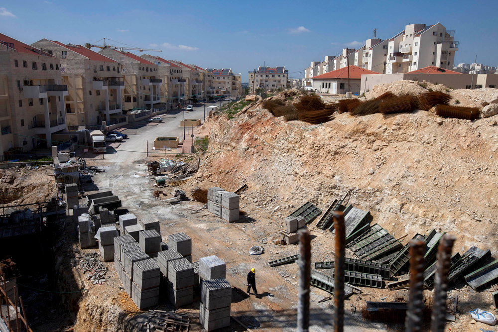 Description of . In this March 14, 2011 file photo, a general view of a construction site in the West Bank Jewish settlement of Modiin Illit. The United Nations' first report on the broad policy of Israeli settlements concluded Thursday that the government's practice of