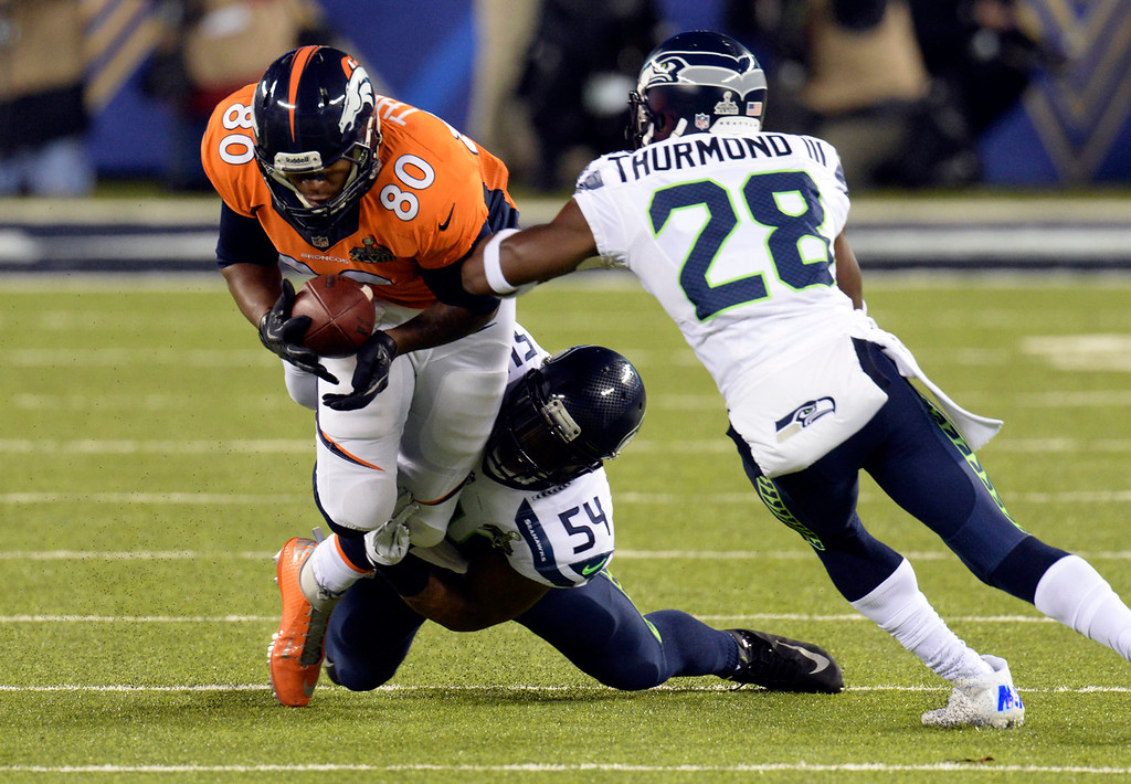 . Denver Broncos tight end Julius Thomas (80) completes a pass but goes down short of a first down in the first quarter.  The Denver Broncos vs the Seattle Seahawks in Super Bowl XLVIII at MetLife Stadium in East Rutherford, New Jersey Sunday, February 2, 2014. (Photo by Hyoung Chang//The Denver Post)